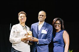 Pam Lewis, right, presents The Small Business Champion award to Tosha Tabron and Derek Edwards of Invest Detroit last year. Lewis is the first recipient of this year's Marlowe Stoudamire Small Business Champion Award.