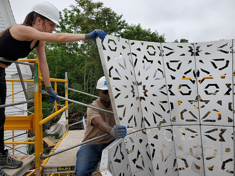 SUNY Purchase College Alum Kat Ermant working with OAAC Artist Jide Aje on the American Riad.