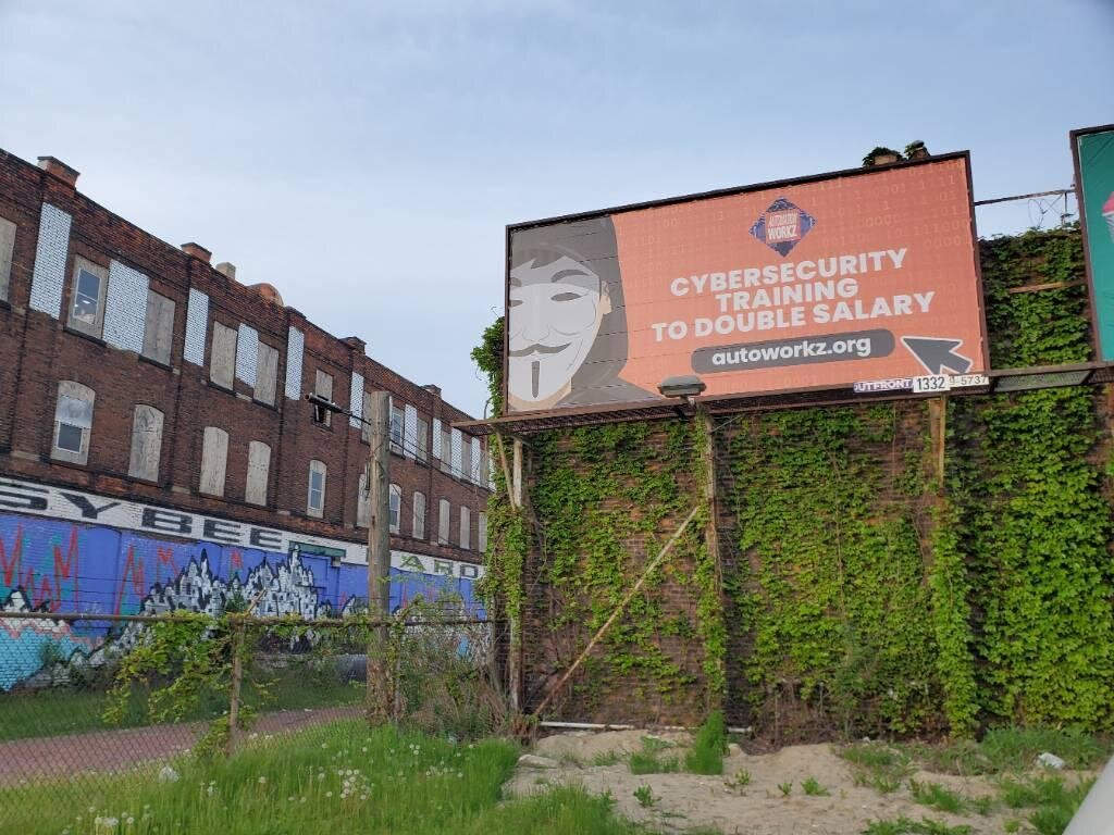 A billboard in Detroit advertises Automation Workz's cybersecurity bootcamp.