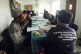 A group of Citywide Poets talk about their writing during a workshop.