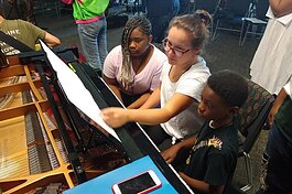 MSU Community Music School students in Detroit get ready to practice piano