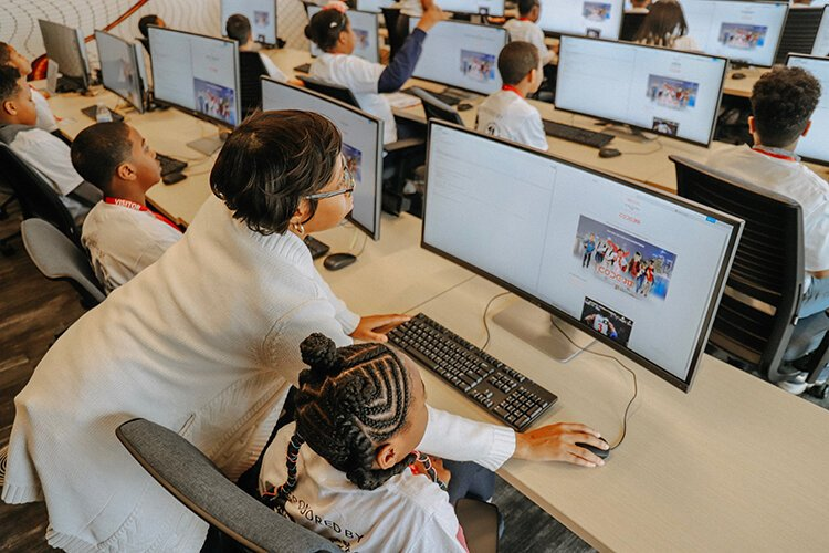 CODE313 teaches computer coding skills to students ranging in ages from 7 to 17 years old.