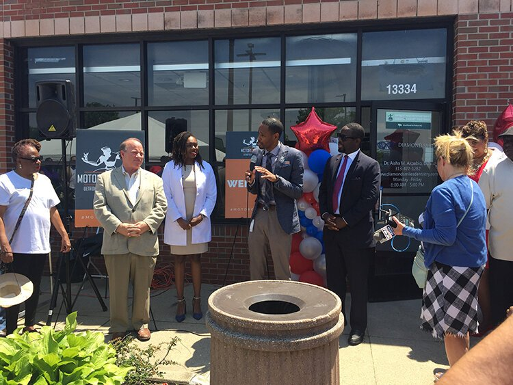 Officials from the city and Motor City Match celebrate at the grand opening of Diamond Smiles. Dentist Aisha Akpabio won a Motor City Match space award, which helped her secure the building, and a $65,000 cash grant from MCM.