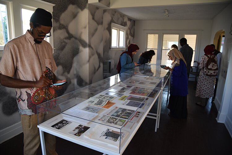 "Choreographer Haleem ""Stringz"" Rasul peruses the Detroit exhibition of Halal Metropolis."