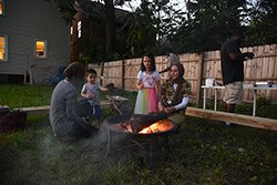 After an event for Detroit Art Week, people enjoyed a campfire at Indus Detroit gallery space with halal s'mores.