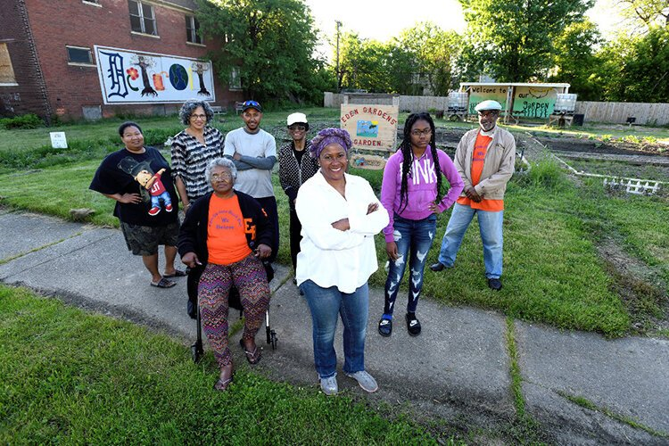 "Eden Gardens Block Club received a KIP:D grant in 2017 to purchase and rehab of a house on Detroit's east side to use as a training center. The grant ""was a hallelujah moment,"" says Eden Gardens Block Club President Karen Knox, center."