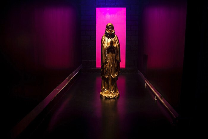 A golden Madonna welcomes visitors to Hygienic Dress League's newest art installation at Bagley Central.