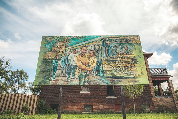 "The mural titled ""The Waiting"" by Nicole Macdonald shows NW Goldberg residents boarding the 29 Linwood bus at the corner of Linwood and Ferry Park."