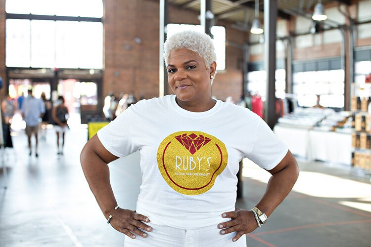 LaShonda Sims leads her all-female, family-run business, Ruby's Natural Hair Care.