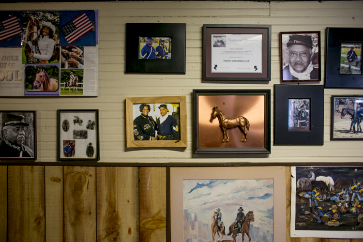 Poster and photographs hanging at the Buffalo Soldiers Heritage Center