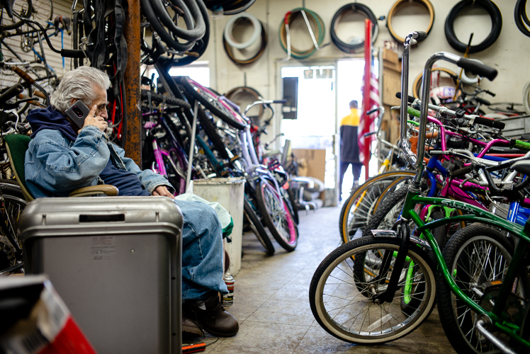 Sam Awada takes a phone call at Livernois Bike Shop.