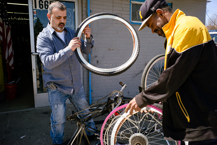Looking at wheels at Livernois Bike Shop.