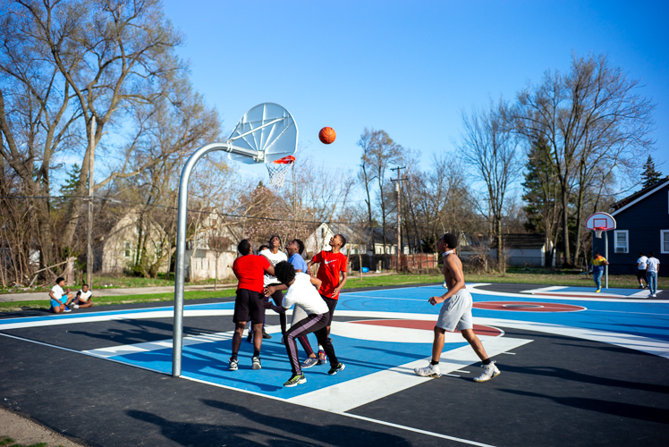 A game of basketball at Ella Fitzgerald Park.