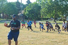 LifeBUILDERS youth play football with DeAngelo Mabone prior to the pandemic.