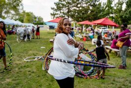 "Bernadette King, a 29-year veteran of the Henry Ford Health System where she coordinates special projects, first brought her love of hooping to others a decade ago as part of a ""recess at work"" program. Photo by Nick Hagen."