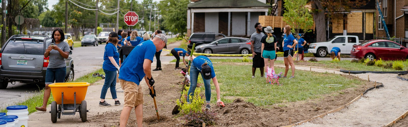 Volunteers from the Detroit Regional Chamber tend to the new art park in NW Goldberg.