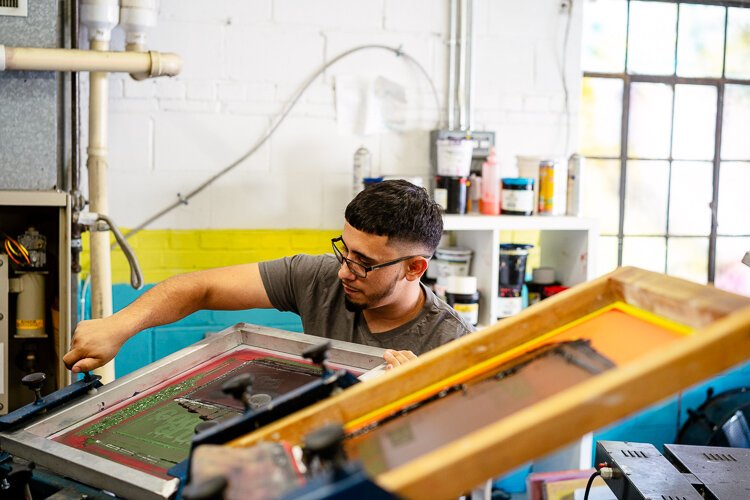 For David Camarena, training the next generation of screen printers seems to be about giving young people in his community a positive career path to focus on instead of the darker road that he once briefly wandered down.
