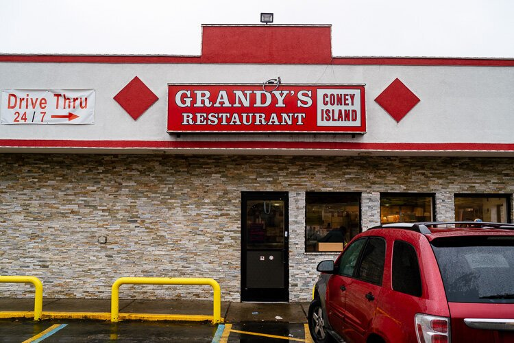 Amy Haimerl starts her day with a hearty meal of eggs, cheese, and bacon at Grandy's Restaurant on the east side.