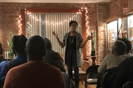 Cornetta Lane speaks at an event at Submerge Records in the North End