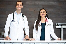 Dr. Paul Thomas, pictured with Dr. Raquel Orlich, is a family medicine doctor and founder of Plum Health Direct Primary Care in Corktown.