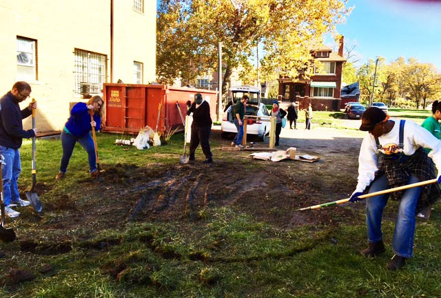 Volunteers learn how to construct rain gardens in Detroit's lower Eastside neighborhood.