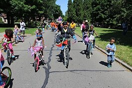 Members of the NRPCA take local youth on a costumed bike ride.