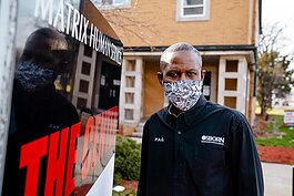 Osborn Business Association Business Manager Paul Garrison dons a mask in front of his group's offices.