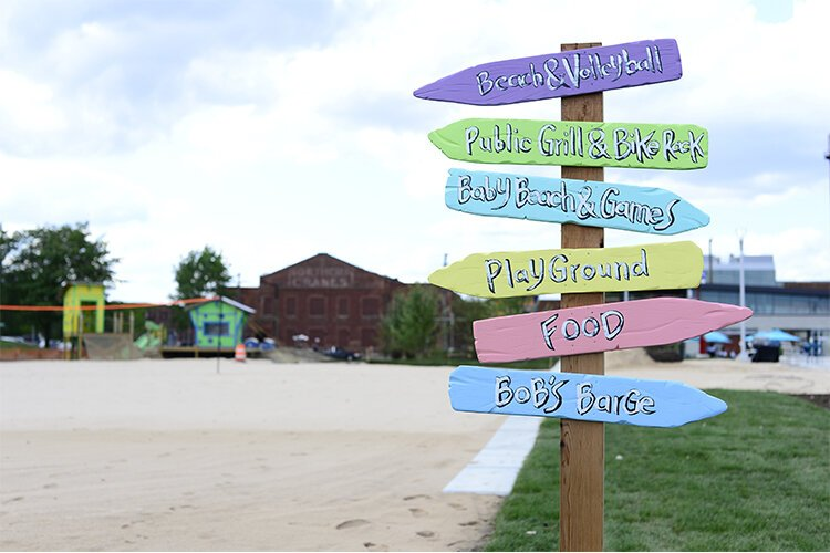 This park features a sandy beach, climbing playscapes, a musical garden, a floating bar, public barbecue grills, and more.