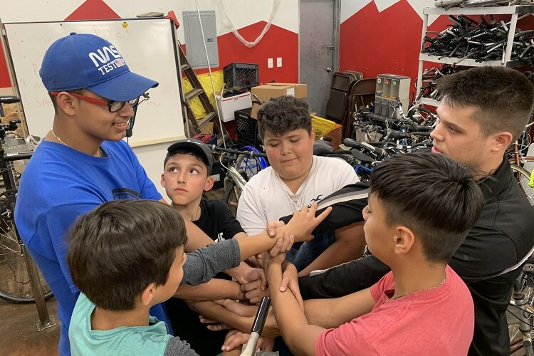 UNI youth learn bike repair at Southwest Rides.