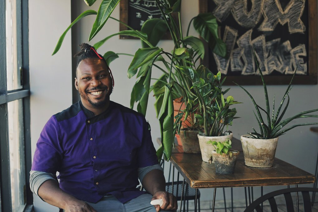 Godwin Ihentuge opened YumVillage restaurant last year in Detroit's New Center neighborhood after having a successful food truck with the same name for the past three years.