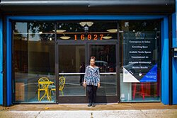 Denise Moore stands in front of ZAB Cultural Collective, her new art gallery and coworking space in East English Village.