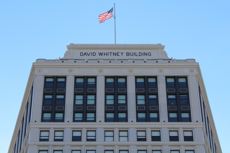 The David Whitney's renovation include a cornice, pediment sign, and lions' heads made by Glassline