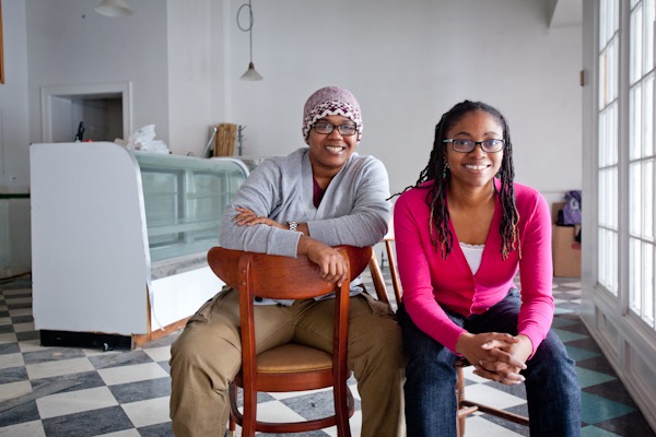 Erika Boyd and Kirsten Urssery sit for a portrait in what will soon be Detroit Vegan Soul