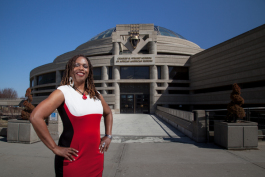 Satori Shakoor in front of the Charles H. Wright Museum of African American History