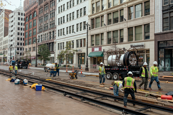 Construction workers busy on a stretch of M-1 along Merchants Row in downtown Detroit