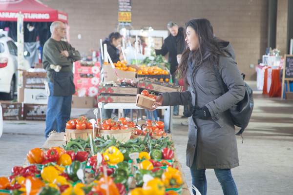A woman purchases Leaminton produce at Eastern Market