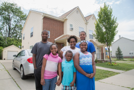 The Simms family in front of their home in Morningside