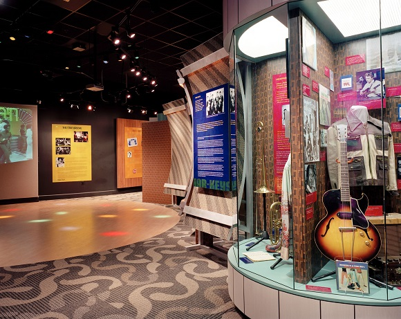 A museum exhibit features a replica of the Soul Train dance floor, circa 1970, with original footage from the program.