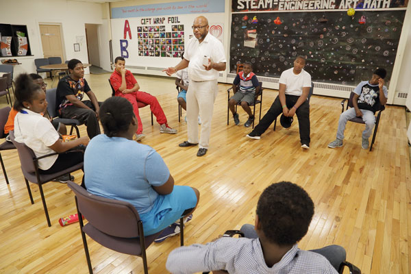Frank McGhee talks to a group of students