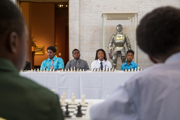 Young Detroit chess players wait to play Grandmaster Hikaru Nakamura
