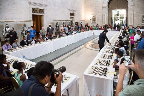 Grandmaster Hikaru Nakamura takes on 50 Detroit-area chess players at once in the DIA's great hall
