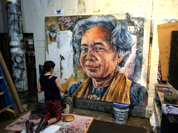 Nicole Macdonald working on her portrait of Melba Joyce Boyd