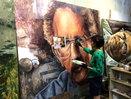 Nicole Macdonald working on her portrait of Philip Levine