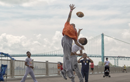 Kids play along the west riverfront