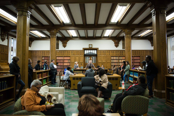 Frank Rashid addresses a group of visitors inside of the library at Marygrove College