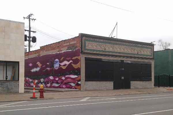A mural painted by returning citizens on a Michigan Avenue commercial building