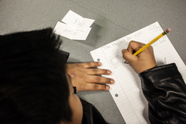 A young writer at work during an 826Michigan workshop at the Campbell Branch Library