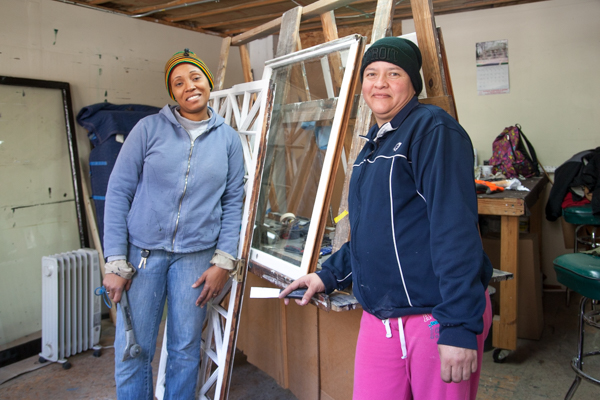 Guisa Suttle and Maria Fernandez glazzing and fitting glass at Turner Restoration's workshop