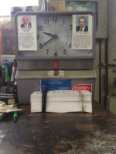 Gerry's time clock, which is adorned with the funeral placards of his former bosses