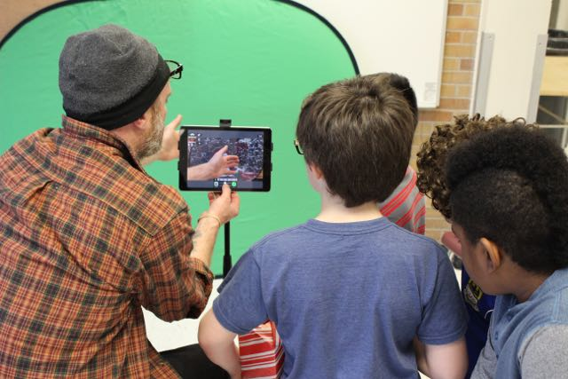 Filmmaker Mikey Brown demonstrates using a handheld camera
